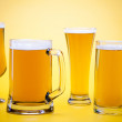 Beer glass with yellow background — Stock Photo #7388290