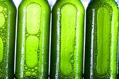 Green bottle of beer — Stock Photo