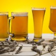 Постер, плакат: Beer glass with yellow background