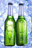Three fresh beers with ice — Stock Photo