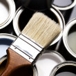 Paint buckets, paint and brush — Stock Photo #7405534