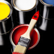 Cans of paint with paintbrush — Stock Photo