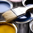 Cans of paint with paintbrush — Stock Photo #7405694