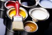 Paint brush and cans — Stock Photo