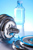 Dumbbell and bottle water — Stock Photo
