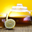 Stock Photo: Glass teapot of tewith lemon
