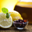 Glass teapot of tea with lemon — Stock Photo