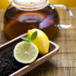Glass teapot of tea with lemon — Stockfoto