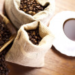 Coffee beans in a cup - Stock Photo