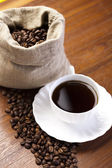Coffee beans in a cup — Stock Photo
