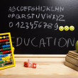 Alphabet and letters on a school blackboard — Stock Photo