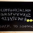Alphabet and letters on a school blackboard — Stock Photo #7457979