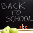 Back to schoo, inscription on blackboard — Stock Photo #7458465