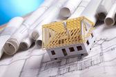House on achitecture plans — Stock Photo