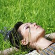 Woman lying on the grass in the park — Stock Photo