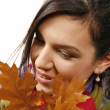 Beautiful woman with a leaf — Stock Photo