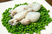 Fresh cuttlefish with peas — Stock Photo