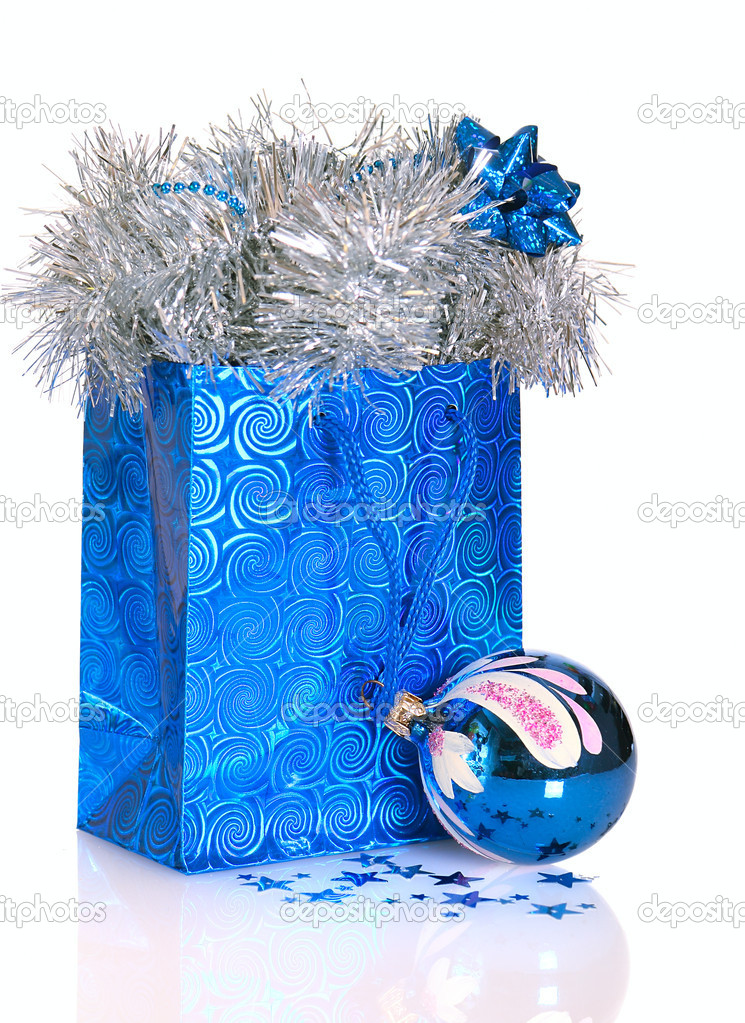 Blue gift bag with Christmas decorations on white background — Stock Photo #7946039