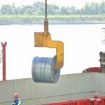 rolos de chapa de aço no porto — Fotografia Stock  #6857415