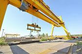Crane and steel plates — Stock Photo
