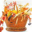 Autumnal basket over white - Stock Photo