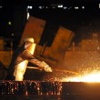 Stok fotoğraf: Worker using torch cutter to cut through metal