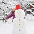 Snowman and  girl - Stock Photo
