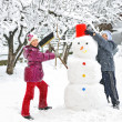 Stock Photo: Snowman and kids