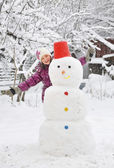 Snowman and girl — Stock Photo