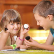 Boy and girl playing with cookies — Stock Photo