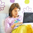 Surprised girl with laptop in her bed — Stock Photo