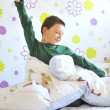 Boy Awakening  in his bed — Stock Photo