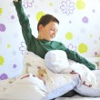 Boy Awakening in his bed — Stock Photo #7936565