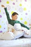 Boy Awakening in his bed — Stock Photo