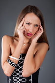 Young woman with severe headache holding forehead in pain — Stock Photo