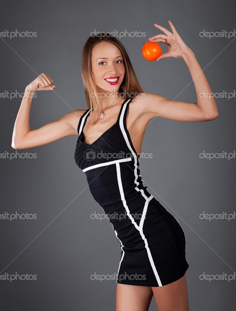 Beauty young happy woman with orange — Stock Photo #7410148