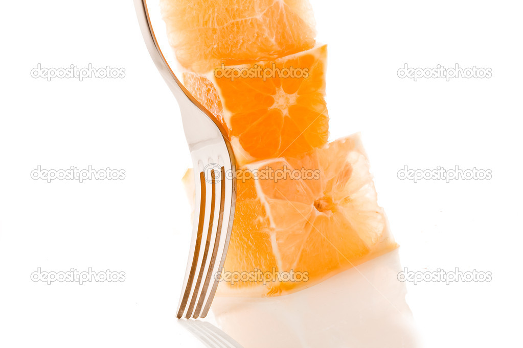 Photo of delicious fresh stacked orange cubes on white background — Stock Photo #7140462