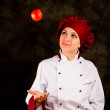 Chef juggling with tomato — Stock Photo