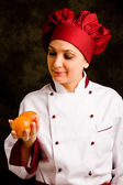 Chef is controlling orange quality — Stock Photo