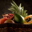 Basket with tropical fruits - Stok fotoğraf