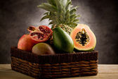 Basket with tropical fruits — Stock Photo