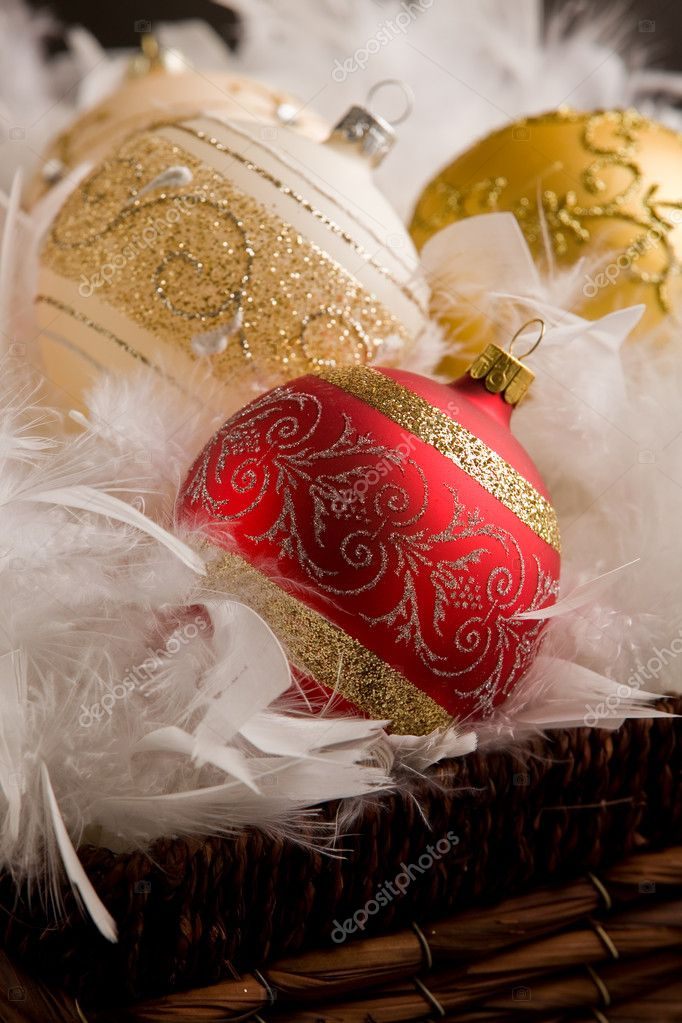 Photo of christmas balls inside a feather basket in front of a rural background — Stock Photo #7308699