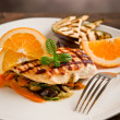 Grilled chicken breast on ratatouille bed - 图库照片