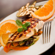 Grilled chicken breast on ratatouille bed - Foto de Stock
