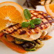 Постер, плакат: Grilled chicken breast on ratatouille bed