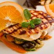 Grilled chicken breast on ratatouille bed - Stock Photo