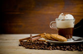 Cappuccino on coffee beans — Stockfoto