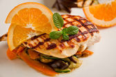 Grilled chicken breast on ratatouille bed — Stock Photo