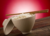 Rice with asian chopstick — Stock Photo