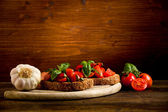 Bruschetta appetizer with fresh tomatoes — Stock Photo